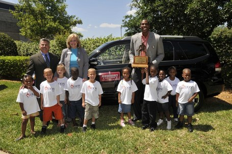 Dwight_defensive_player_of_the_year_with_kia_and_kids_fma3423resize1_medium