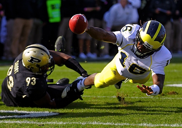 Purdue-denard_robinson__kawann_short