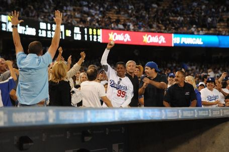 Jermaine Jackson, catching a foul ball this season at Dodger Stadium