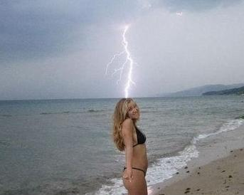 Lightning-striking-girl_medium