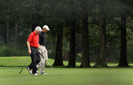 Obama_and_clinton_golf_via_chris_kleponis-pool_getty_images_medium