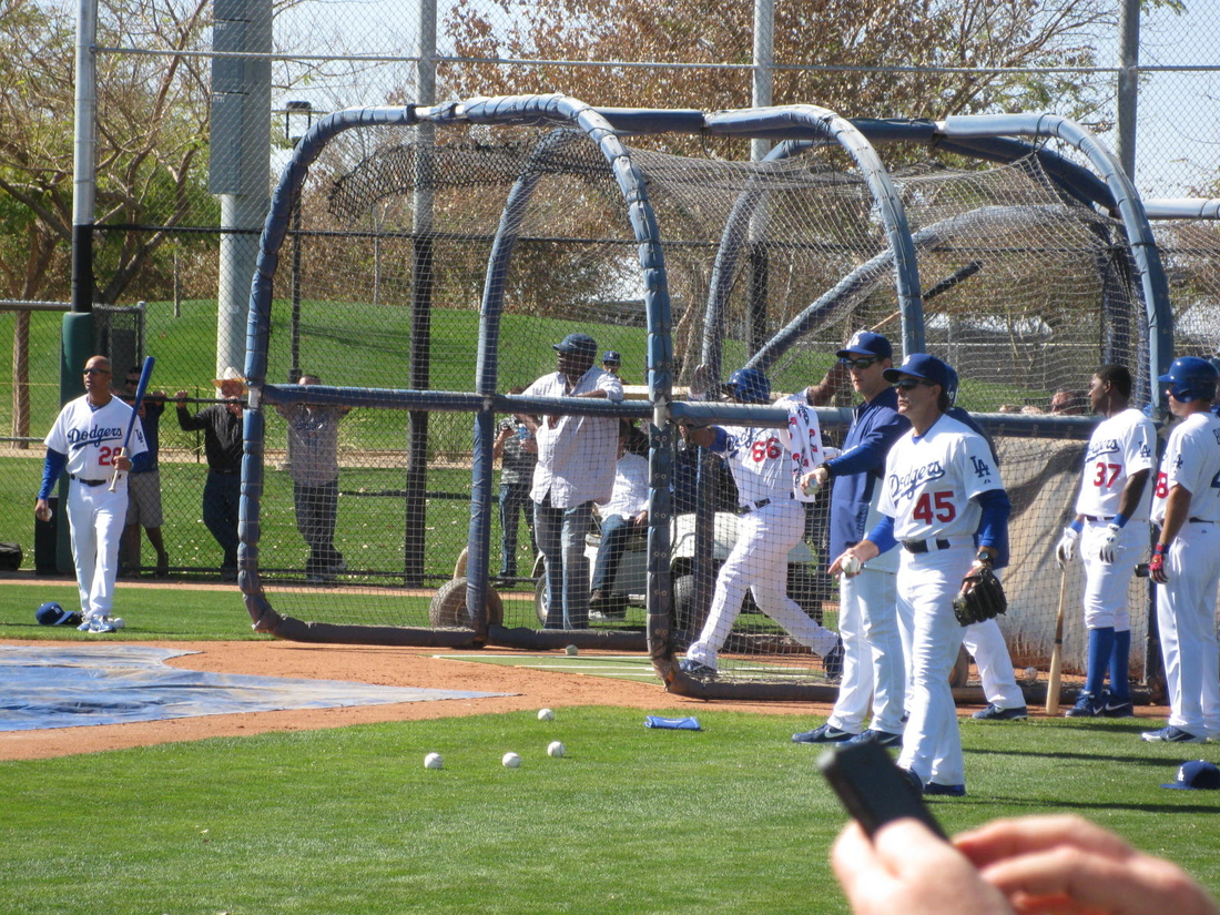 Yasiel Puig draws a crowd during batting practice