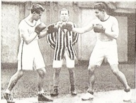 Eddie_eagan__olympic_light-heavyweight_champion__sparring_with_ouabc_captain_the_marquis_of_clydesdale_medium