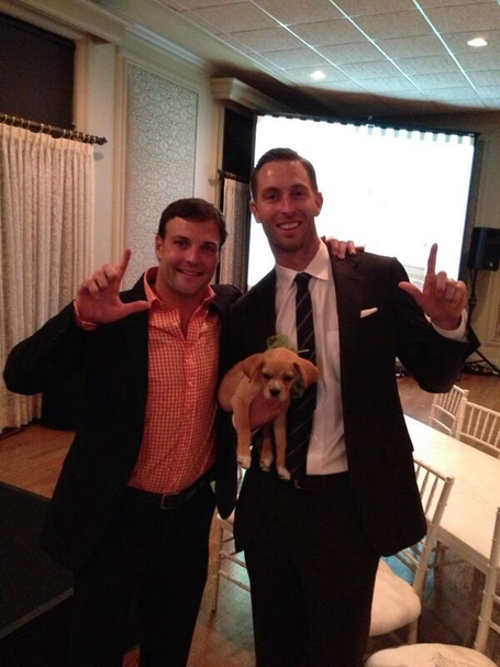 Wes Welker, Kliff Kingsbury, and a puppy? Wes Welker, Kliff Kingsbury, and a puppy.