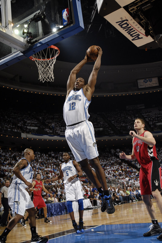 Dwight Howard of the Orlando Magic rebounds against the Toronto Raptors in Game One of their NBA Playoffs series on April 21st, 2008.
