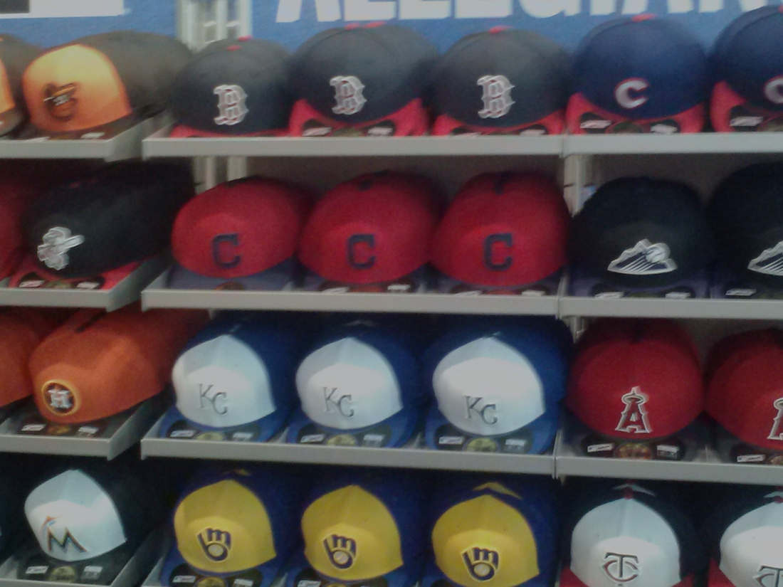 2cf8167126b Neyer visited both cap displays at the MLB Clubhouse store. Both of them  featured the Indians  block-C caps (red and ...