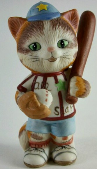 Kitten_-_with_bat_and_ball_medium