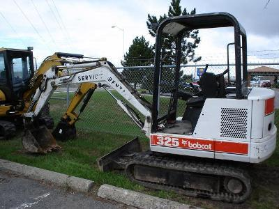 Used_construction_equipment_bobcats_excavators_dump_trucks_medium