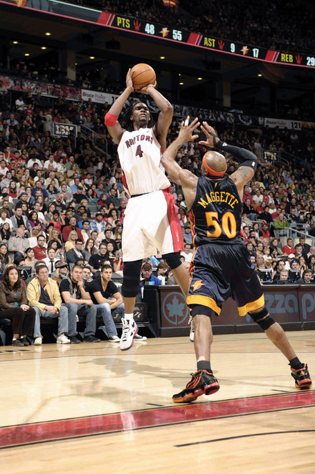 Chris_bosh__4_of_the_toronto_raptors_takes_the_mid-range_jumper_over_corey_maggette__50_of_the_golden_state_warriors_medium