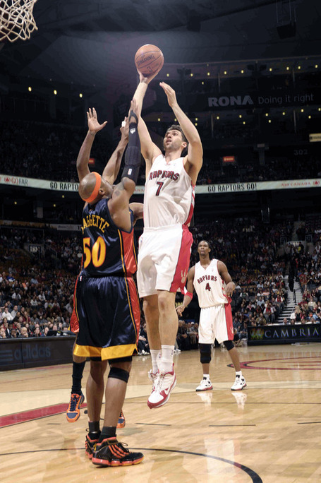 Andrea_bargnani__7_of_the_toronto_raptors_drives_the_lane_and_tries_the_floater_over_corey_maggette__50_of_the_golden_medium