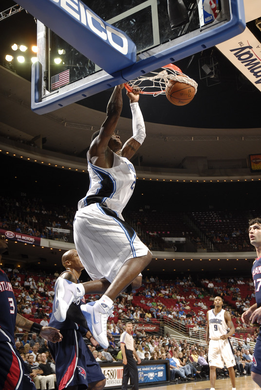 Mickael Pietrus of the Orlando Magic dunks with two hands in a preseason NBA basketball game versus the Atlanta Hawks on October 6th, 2008.