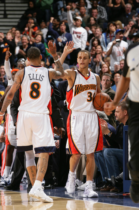 Stephen_curry__30_and_monta_ellis__8_of_the_golden_state_warriors_give_each_other_a_high_five_in_a_game_against_the_medium