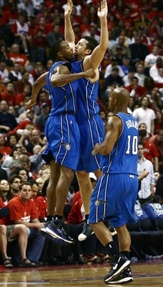 Rashard Lewis, Hedo Turkoglu, and Keith Bogans celebrate during the Orlando Magic's 106-94 victory over the Toronto Raptors on April 26th, 2008