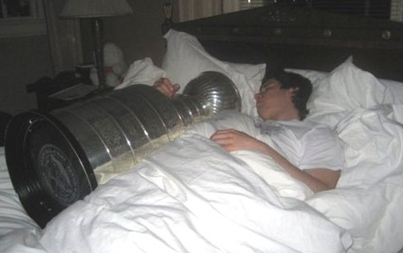 Sidney-crosby-sleeps-with-the-stanley-cup_medium