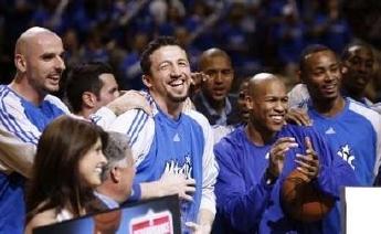 Hedo Turkoglu and his Orlando Magic teammates celebrate Turkoglu's winning the NBA's Most Improved Player Award for the 2007/2008 season.