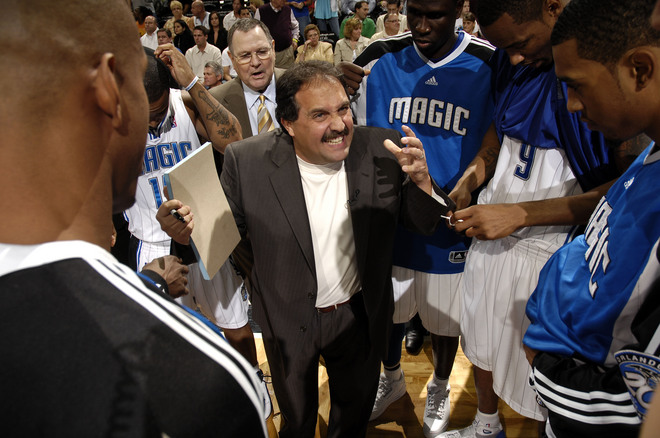 Orlando Magic head coach Stan Van Gundy yells at his team in the huddle during a timeout.