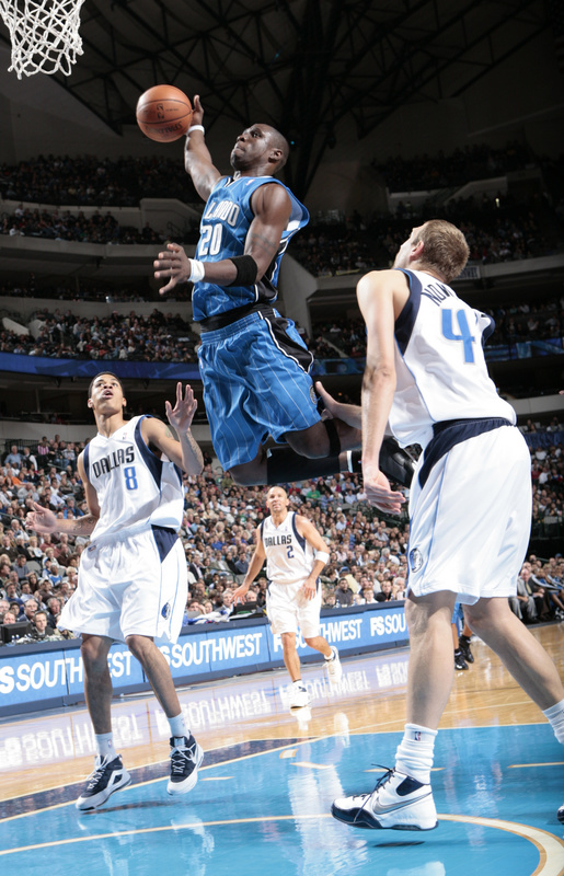 Orlando Magic shooting guard Mickael Pietrus leaps for a tomahawk slam dunk against Dirk Nowitzki of the Dallas Mavericks in a National Basketball Association game at American Airlines Center in Dallas, Texas on November 14th, 2008. Orlando won, 102-100.