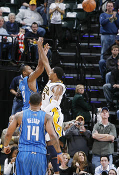 Rashard Lewis of the Orlando Magic shoots the go-ahead jumper over Danny Granger of the Indiana Pacers. The basket gave the Magic a 100-98 lead with 23 seconds to play.