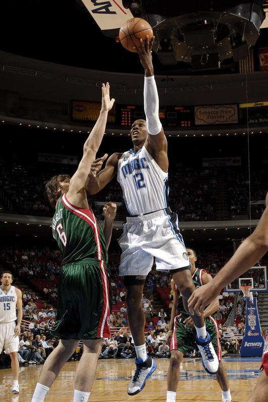 Orlando Magic center Dwight Howard shoots a left-handed hook shot against Andrew Bogut of the Milwaukee Bucks in their NBA basketball game on November 24th, 2008.