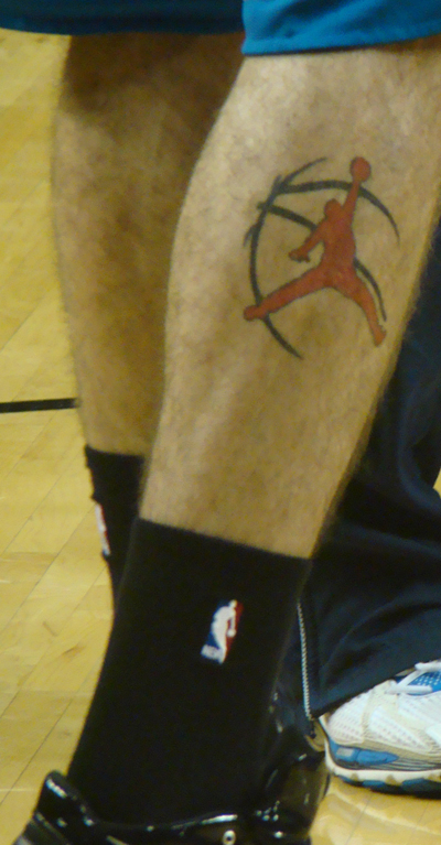 He has an interesting tattoo on his right leg: http://images.cbsspo OOPS!