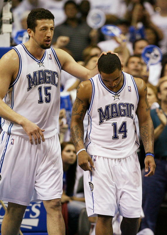Hedo Turkoglu comforts Jameer Nelson after the Orlando Magic lost to the Detroit Pistons, 90-89, to fall to a 3-1 NBA playoffs series deficit.