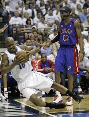 Keith Bogans of the Orlando Magic is fouled by Richard 'Rip' Hamilton of the Detroit Pistons while grabbing a rebound in Game Four of the 2008 Eastern Conference Semifinals