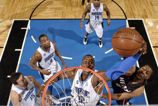 Dwight Howard of the Orlando Magic battles with Jamaal Magloire of the Miami Heat for a rebound in their NBA basketball game on January 2nd, 2008. The Magic won, 86-76.