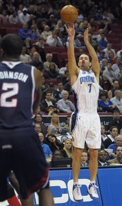 J.J. Redick of the Orlando Magic shoots a three-pointer as Joe Johnson of the Atlanta Hawks looks on in their NBA basketball game on January 9th, 2009. Orlando won, 121-87.