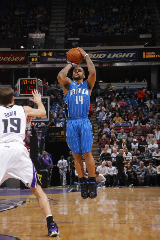Jameer Nelson of the Orlando Magic shoots a three-point field goal against Beno Udrih of the Sacramento Kings in their NBA basketball game on Tuesday, January 13th, 2009. The Magic won, 139-107, and set an NBA record by making 23 three-point field goals as a team