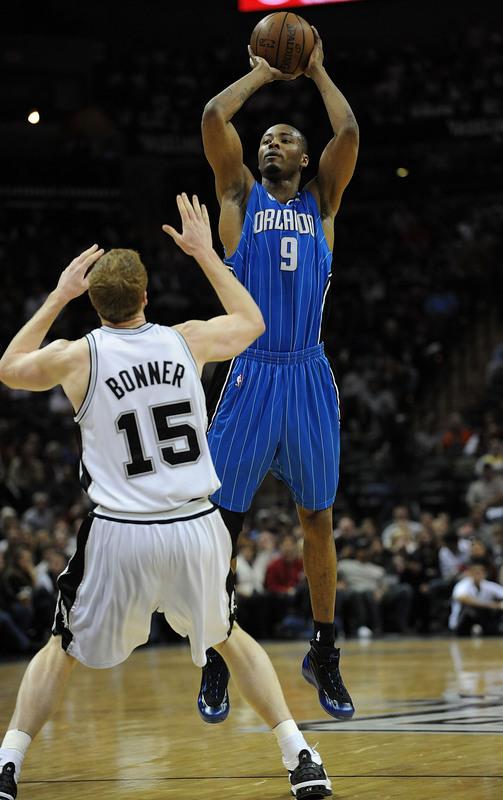 Rashard Lewis of the Orlando Magic shoots a three-point field goal against Matt Bonner of the San Antonio Spurs in their NBA basketball game on Sunday, January 11th, 2009. The Magic won, 105-98