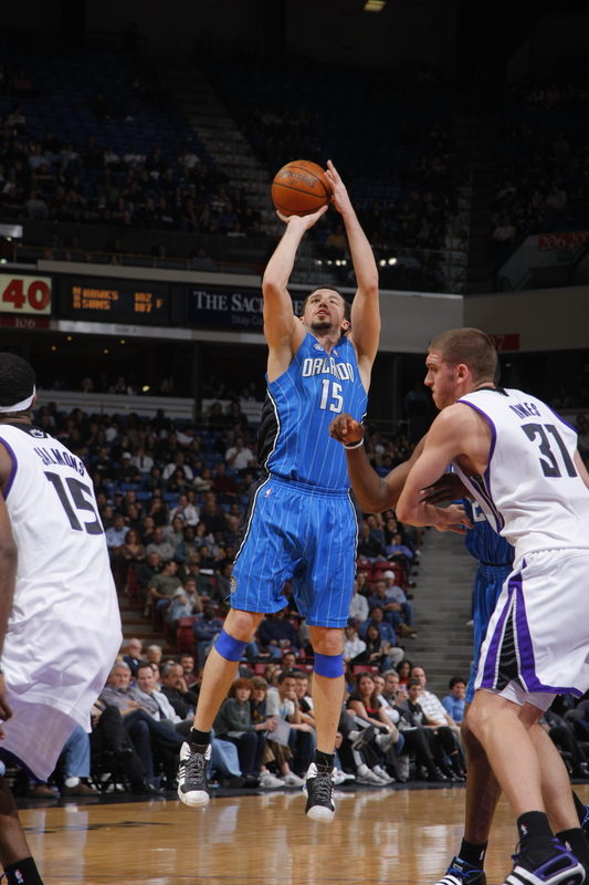 Hedo Turkoglu of the Orlando Magic shoots a three-point field goal against Spencer Hawes and John Salmons of the Sacramento Kings in their NBA basketball game on Tuesday, January 13th, 2009. The Magic won, 139-107, and set an NBA record by making 23 three-point field goals as a team