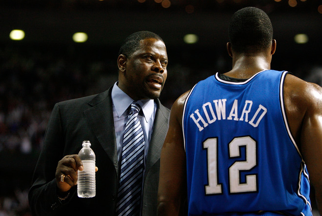Orlando Magic assistant coach Patrick Ewing talks to Magic center Dwight Howard during a timeout in an Orlando Magic/Detroit Pistons NBA Eastern Conference Semifinals game.
