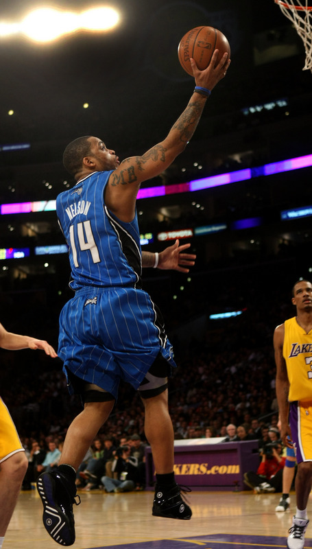 Orlando Magic guard Jameer Nelson shoots a laup against the Los Angeles Lakers in Orlando's 109-103 victory on Friday night. Nelson scored 28 points, grabbed 6 rebounds, and handed out 6 assists; he also scored 15 points in the fourth quarter to lead Orlando past Los Angeles for its first-ever series-sweep of the Lakers