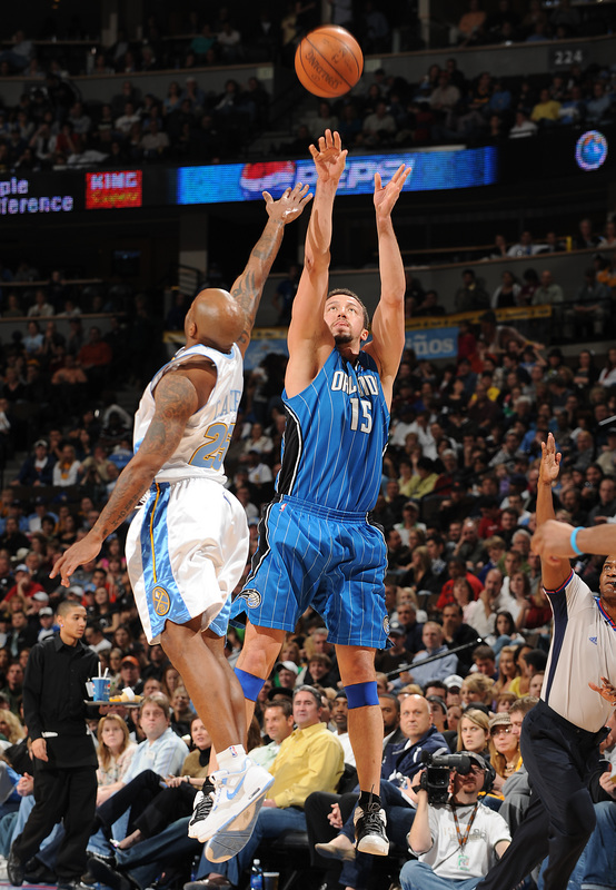 Orlando Magic forward Hedo Turkoglu shoots over Denver Nuggets guard Anthony Carter in Orlando's 106-88 victory over the Nuggets on Saturday, January 17th, 2009