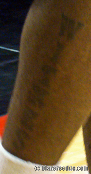 Best cycling tattoo ever: the classic chain ring smudge on the inner calf.