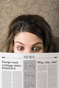 Woman-reading-newspaper_medium