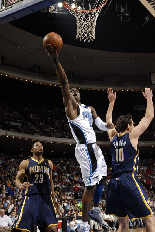 Orlando Magic guard Mickael Pietrus shoots a layup over Indiana Pacers center Jeff Foster during Orlando's 135-111 win on Tuesday, January 27th, 2009. Pietrus had 27 points and 10 rebounds in his return from a 12-game absence due to a broken right wrist.