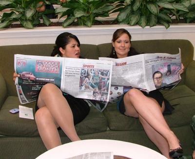 Um_20aibl_20girls_20reading_20newspaper_preview_medium