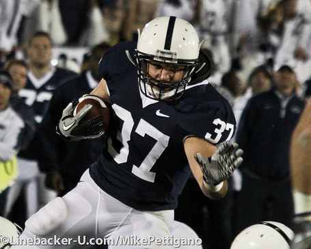 Joe_suhey_stiffarm_vs_michigan_2010_medium