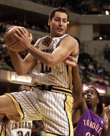 Jeff Foster of the Indiana Pacers grabs a rebound in front of Alvin Williams of the Toronto Raptors.