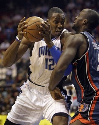 Orlando Magic center Dwight Howard powers through the defense of Charlotte Bobcats center Emeka Okafor in Orlando's 107-102 win over Charlotte on Tuesday, February 17th, 2009. Howard scored a career-high 45 points in the victory.
