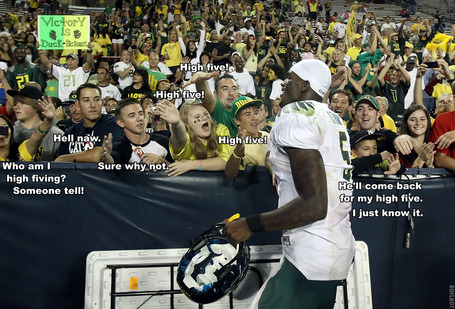 Darron Thomas high-fiving Oregon fans.