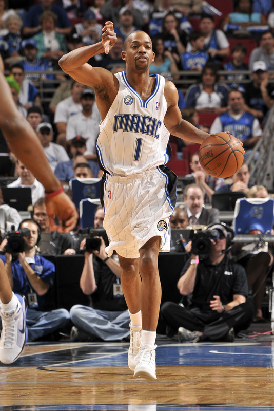 Orlando Magic point guard Rafer Alston dribbles the ball upcourt against the Miami Heat