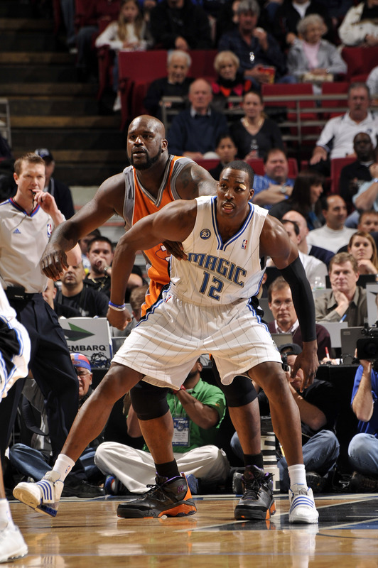 Dwight Howard of the Orlando Magic battles for position with Shaquille O'Neal of the Phoenix Suns during the Magic's 111-99 victory over Phoenix on Tuesday, March 3rd, 2009