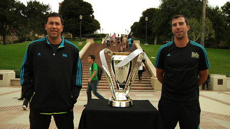 Head_coach_jorge_salcedo_and_assistant_coach_kenny_arena__both_former_mls_players__welcome_the_trophy_the_ucla_campus_medium