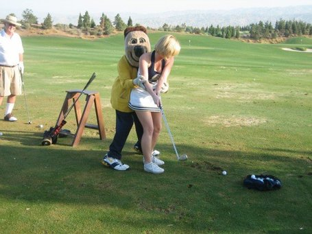 Oski_helps_me_golf_medium