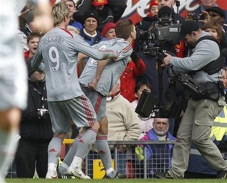 Gerrard_kisses_camera_medium