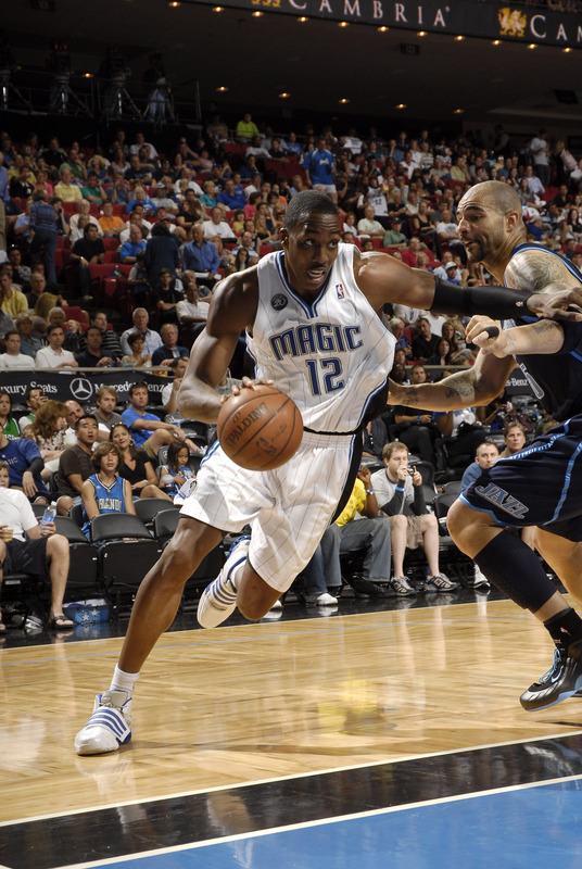 Dwight Howard of the Orlando Magic drives baseline against Carlos Boozer of the Utah Jazz in Orlando's 15-87 victory on Sunday, March 15th, 2009.