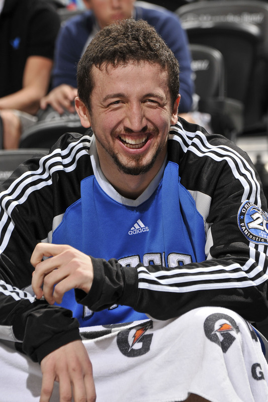 Hedo Turkoglu of the Orlando Magic smiles while sitting on the bench during Orlando's 105-87 defeat of the Utah Jazz on Sunday, March 15th, 2009.
