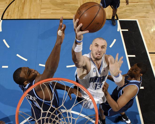 Orlando Magic center Marcin Gortat shoots a layup as Utah Jazz players defend in Orlando's 105-87 win on Sunday, March 15th, 2009.